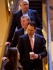 AT&T's chief lobbyist, Bob Quinn, accompanies CEO Randall Stephenson in a visit to Trump Tower on Jan. 12, 2017.