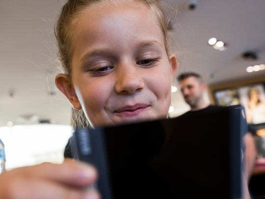 Rylie Hood, 8, looks at a photo of herself during a workshop aimed at improving self-confidence. The project is a body empowerment program teaching mindfulness, acceptance and self-care skills. Lululemon in Palm Desert is also participating in this program.