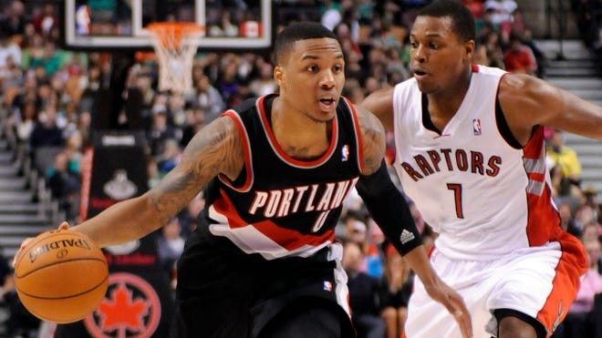 Blazers point guard Damian Lillard drives past Raptors point guard Kyle Lowry during Sunday's 118-110 overtime win.