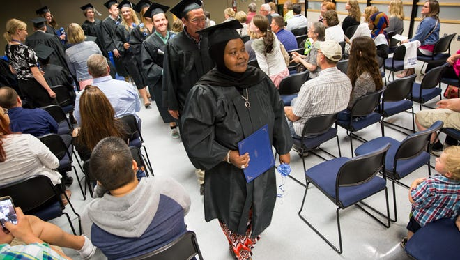 Ambio Munie, 50, receives her GED from Moraine Park Technical College on June 13. It took the Somalia native six years to earn her degree.