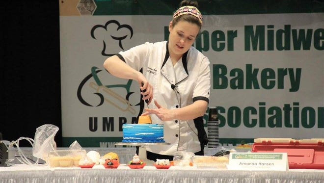"""Cake decorator Amanda Hansen of Coborn's demonstrates at the 2016 Upper Midwest Bakery Association convention in Red Wing. Hansen has previously competed on the Food Network's cake decorating competition show, """"Cake Wars."""""""