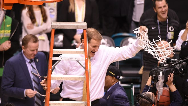 March 12, 2016; Las Vegas, NV, USA; Oregon Ducks head coach Dana Altman celebrates after cutting down the net after the championship game of the Pac-12 Conference tournament against the Utah Utes at MGM Grand Garden Arena. The Ducks defeated the Utes 88-57. Mandatory Credit: Kyle Terada-USA TODAY Sports