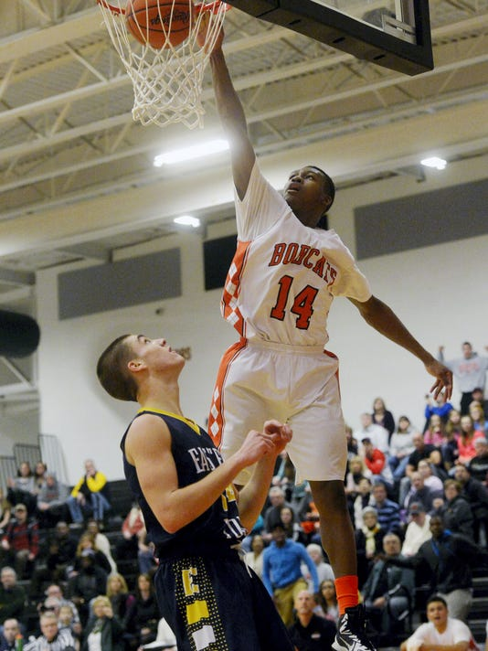 Northeastern's DeAireus Brown sinks his second dunk against Eastern York in the second half of a boys basketball game on Wednesday, Jan. 14, 2015, at Northeastern. Northeastern defeated Eastern York 44-38. Chris Dunn — Daily Record/Sunday News