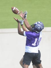 ACU safety Charleston White, left, a senior transfer from Washington State, intercepts a pass in the end zone during the team's first fall practice Thursday, Aug. 3, 2017 at Wildcat Stadium.