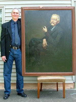 "Matthew Schwartz, a Cherry Hill art dealer, is shown with ""1934 Farmer,"" an oil painting from the Depression Era."