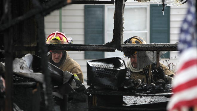 "Elsmere firefighters Jeff Hampton, left, and Lt. Rob Samuel at a mobile home fire.  The Enquirer/Carrie Cochran ELSMERE FIRE Friday January 14, 2011 KENTUCKY  Elsmere firefighter Jeff Hampton, left, and Lt. Rob Samuel, look for hot spots in a single-wide mobile home Friday, which was destroyed by a fire in the 100 block of Hawk Drive in Elsmere. The one occupant of the home escaped with only minor injuries, said Elsmere Asst. Fire Chief Tim Sheehan. Two dogs and a kitten were rescued. The call came in at 6:20 am, he said.   ""It doesn't take much, and it already had pretty good start,"" said Sheehan, whose crews arrived with 40% of the home already involved in fire.   Sheehan also said that early morning wind conditions made the fire difficult to extinguish.   Kenton County Fire Investigators were on the scene as Eslmere fire crews continued to put out hot spots. A cause has yet to be determined.  Sheehan said that the occupant would be staying with nearby family. The Enquirer/Carrie Cochran"