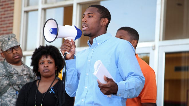 """Grambling football player Naquan Smith speaks at a """"State of Emergency"""" gathering organized by student Kimberly Monroe in Grambling, La., on Thursday. Smith said the team had concerns about the football coaching staff and facilities. After two days of players skipping practice, Grambling spokesman Will Sutton announced Dustin """"Dirt"""" Winston as the new interim football coach shortly following the student demonstration."""