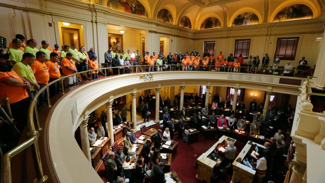 Members of LiUNA, Laborers International Union of North America, fill the gallery in support of the Transportation Trust Fund bill during a voting session in the Senate chamber at the State House in Trenton, NJ Monday June 27, 2016.