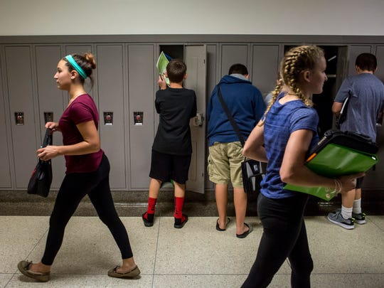 Students walk through a hallway and stop at their lockers Tuesday, September 13, 2016 at Marysville Middle School. Marysville Public Schools have received the most Schools of Choice applications of any district in St. Clair County and brought in 114 students this academic year.