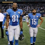 The Detroit Lions' Calvin Johnson, left, and Golden Tate leave the field Jan. 4, 2015, in Arlington. Texas.