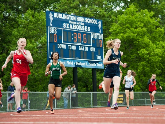 Girls compete in the 800m race during the division I high school track and field state championships at Burlington High School on Saturday June 3, 2017 in Burlington. (BRIAN JENKINS/for the FREE PRESS)