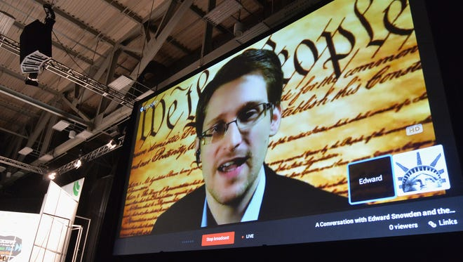 NSA whistle-blower Edward Snowden speaks via videoconference during the 2014 SXSW Music, Film + Interactive Festival at the Austin Convention Center on March 10 in Austin, Texas.