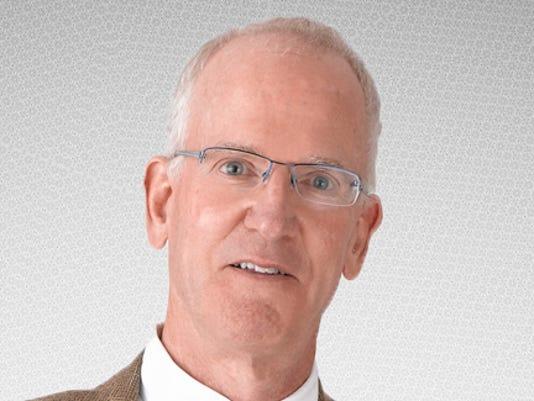 636465130114489389-JGW---Headshot-Grey-Background.jpg