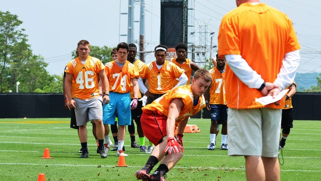 Tennessee football coach Butch Jones watches on as Junior Denton performs a drill earlier this month in Knoxville, Tenn.