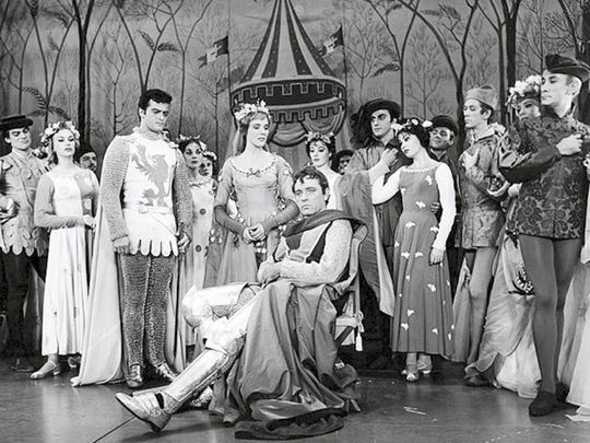 """Lyricist Michael Colby grew up in New York City, and was offered a part in the original run of """"Camelot"""" by Lerner and Loewe. The Broadway musical starred Richard Burton, Julie Andrews and Robert Goulet.  Burton, seated, poses with original cast members of 'Camelot' in this 1960 photo."""