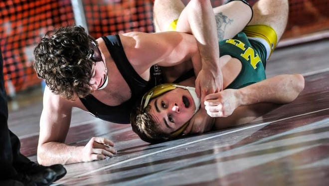North Hunterdon's Tucker Kirchberger (bottom) tries to escape the hold of St. Peter's Prep's Nichols Santos during their 145-pound bout at the Region IV quarterfinals on Friday at Union High School.