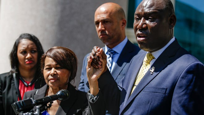 (Right to Left) Attorney Ben Crump, co-counsel Mike Laux, Cheryl Ellis, and Salisa Luster Harrison, stand outside the Jefferson County Judicial Center on June 19, 2018, as they announce a lawsuit against various law enforcement members that alleges mishandling of Harrison's rape kit case.