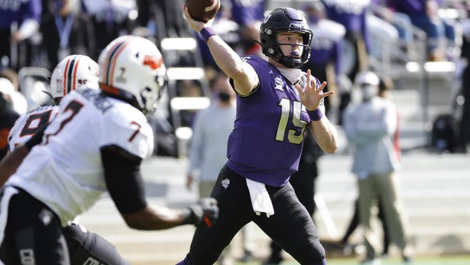 TCU quarterback Max Duggan (15) throws down field against Oklahoma State during the first half of an NCAA college football game Saturday, Dec. 5, 2020, in Fort Worth, Texas.