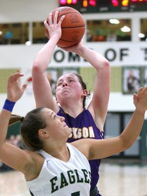 Jackson's Emma Dretke (back) pulls down a rebound behind GlenOak's Kamryn Vance during the third quarter of their game at GlenOak in January.