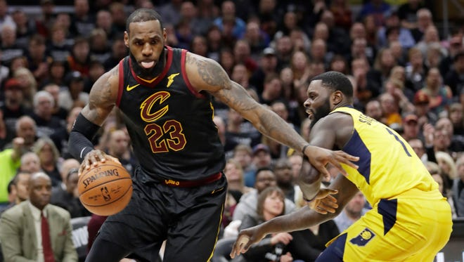 Cleveland Cavaliers' LeBron James, left, drives past Indiana Pacers' Lance Stephenson in the first half of Game 7 of an NBA basketball first-round playoff series, Sunday, April 29, 2018, in Cleveland.
