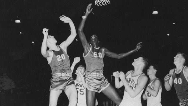 Gene Flowers (No. 20) jumps for the ball during his playing days at Muncie Central. Flowers was a three-year starter for the Bearcats.