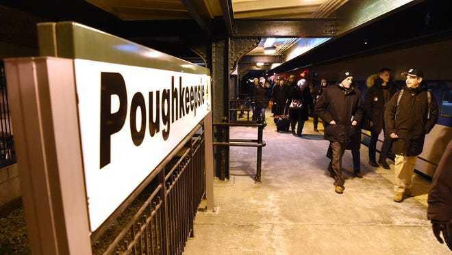 Riders get off a Metro North train at the Poughkeepsie train station.