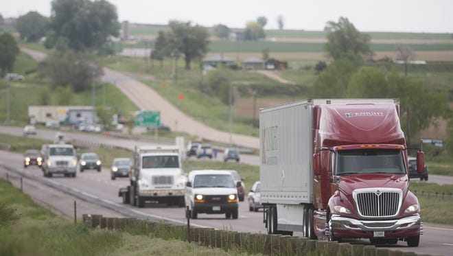 Traffic travels on Interstate 25 in this file photo.