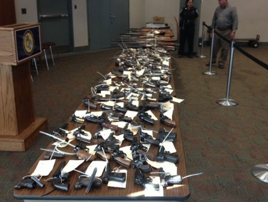 Rochester police display the guns collected at one