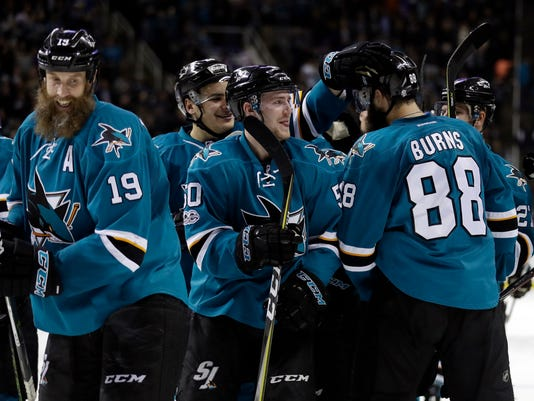 San Jose Sharks defenseman Brent Burns (88) celebrates his game-winning goal with teammates during overtime of an NHL hockey game against the New York Rangers Tuesday, March 28, 2017, in San Jose, Calif. (AP Photo/Marcio Jose Sanchez)