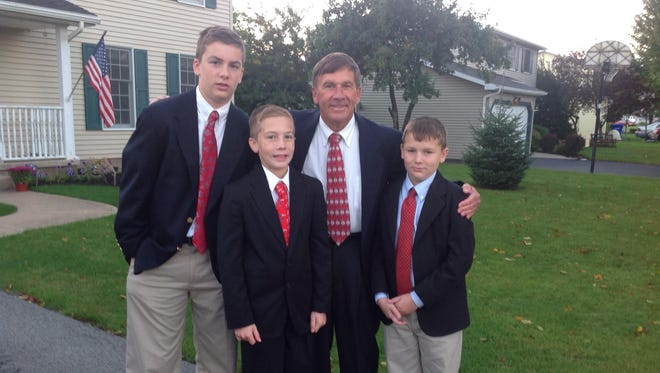 Joe Wielgosz, of Clarkson, with sons, from left, John, Michael and David.