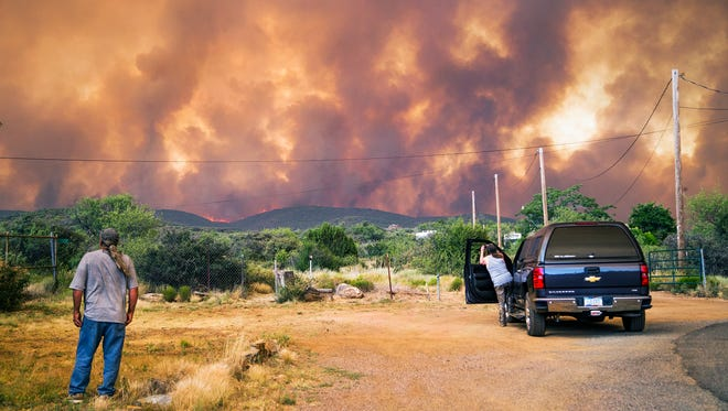 Don Sandy, left, watchs the Goodwin Fire as seen from his house in the town of Mayer, Tuesday, June 27, 2017.  Mayer was later evacuated.