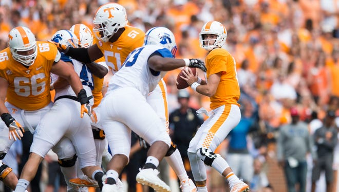Vols quarterback Quinten Dormady (12) looks to pass against Indiana State on Saturday, Sept. 9, 2017.