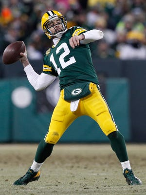 Green Bay Packers quarterback Aaron Rodgers (12) throws a hail mary for a touchdown against the New York Giants during the second quarter.