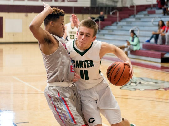 Carter's Adam Hurd is defended by Austin-East's Jalen Tate during the Super 16 Tournament at Bearden High Schools on Thursday, December 29, 2016.