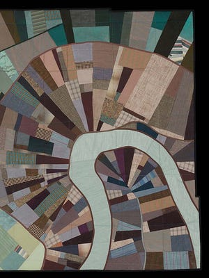 Madison-based textile artist Leah Evans creates map-inspired quilted wall hangings.
