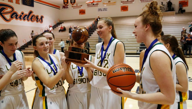 Benton Central players celebrate after defeating Central Catholic 48-33 in the  championship of the J&C Hoops Classic Saturday, November 21, 2015, at Harrison High School.