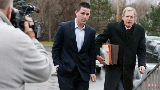 Thomas Clayton walks with his lawyer Ray Schlather to the Steuben County Courthouse on Dec. 17, 2015. Clayton pled not guilty to murder charges stemming from his wife's death on Sept. 29, 2015 in their Caton home.