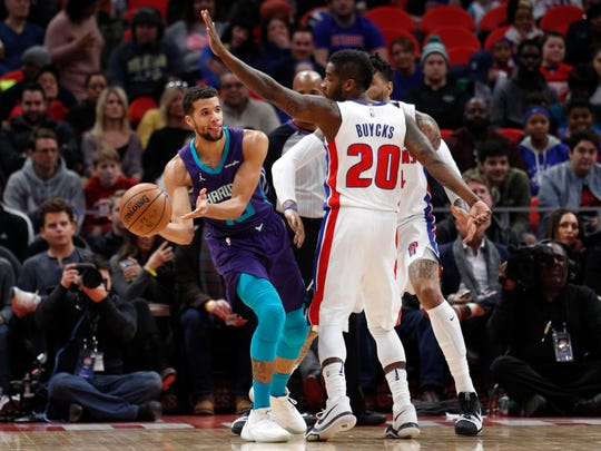 Jan 15, 2018; Detroit, MI, USA; Hornets guard Michael Carter-Williams looks to pass against Pistons guard Dwight Buycks during the first quarter at Little Caesars Arena.