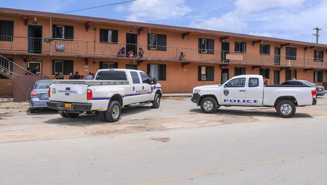 In this PDN file photo, Guam Police Department vehicles are parked in front tof the Hemlani's Harmon Apartments on June 22, 2016. Police responded the the apartments again on Thursday, March 31, after a stabbing was reported, GPD spokeswoman Capt. Kim Santos said.