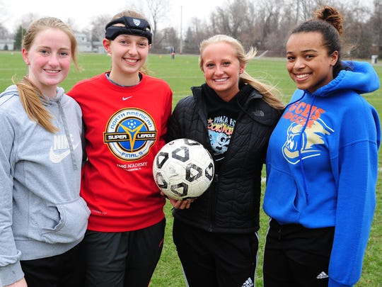 Pictured (from left) are Garden City soccer captains Skyler Clendening, Angie Dimopulos, Alyssa Hurley and Chelsea Booker.