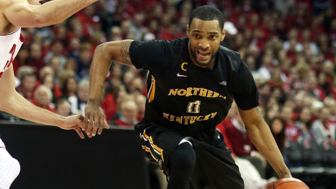 Northern Kentucky guard Chad Jackson attempts to move the ball against Wisconsin guard Sam Gasser on Friday night.