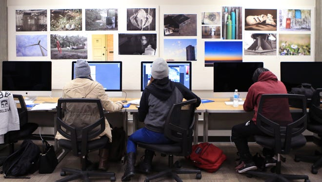 Del Mar College student Lindsey Knowlton (from left), Alex Chapa and Oanh Lai work on photos in the newly upgraded digital imaging lab at the college on Monday, December 5, 2016. The lab includes 15 iMacs, Epson scanners, Canon Digital Rebel cameras and an Epson large format printer. It also includes a black and white darkroom and lighting studio.