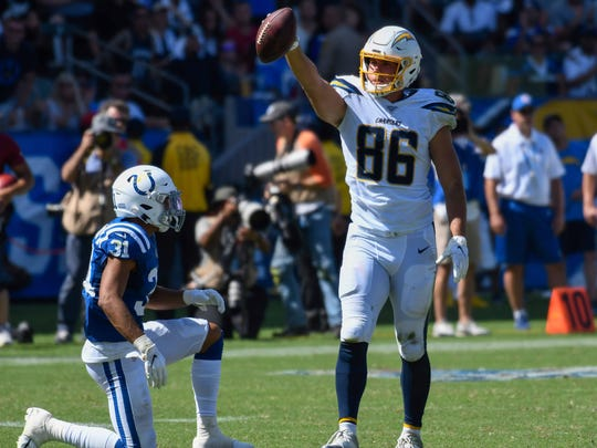 Sep 8, 2019; Carson, CA, USA; Los Angeles Chargers tight end Hunter Henry (86) signals a 1st down after making a catch on Indianapolis Colts cornerback Quincy Wilson (31) in the 3rd quarter at Dignity Health Sports Park. Mandatory Credit: Robert Hanashiro-USA TODAY Sports