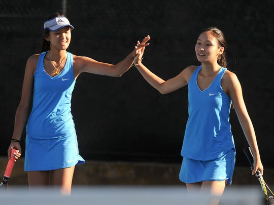 Katherine Ho (left) and Cherry Huang form a powerful doubles team for the Westlake High girls tennis team.
