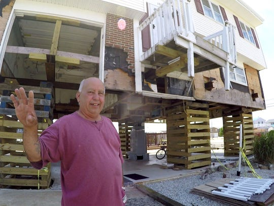Little Egg Harbor resident Edwin Byk stands in front of his lifted home on East Navesink Drive Monday, June 12, 2016.  He decided to elevate his home after it was flooded with more than three feet of water during superstorm Sandy, but unfortunately his contractor, J&N, elevated the house (without permits) and then left, leaving Edwin in the lurch.