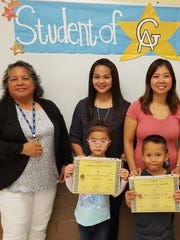 The Guahan Academy Charter School honored its December Student of the Month awardees on Jan. 11. Pictured from left (front row): Paislee Concepcion and Frederico Dela Cruz. Pictured back row from left: Mary Mafnas, Dean of Elementary School Guahan Academy Charter School; Jamie Indalecio andTanya Pangelinan.