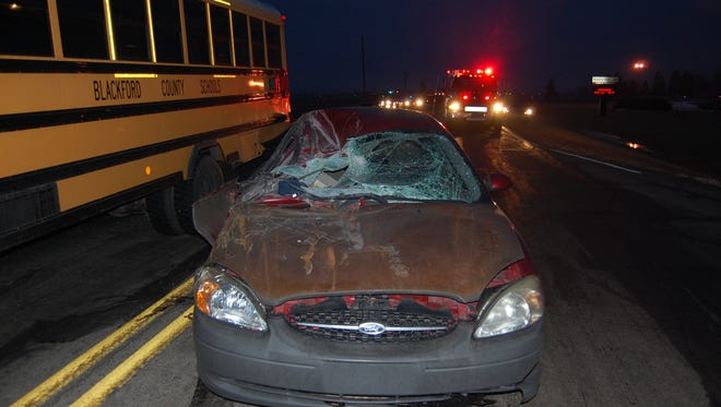 A car on Tuesday morning struck the rear of a bus preparing to turn into Blackford High School.