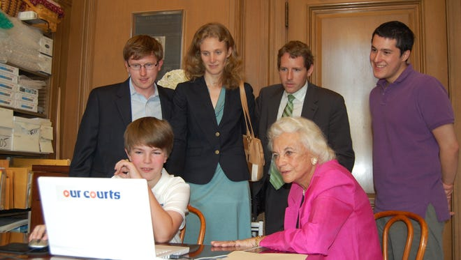 U.S. Supreme Court Justice Sandra Day O'Connor (seated, right) watches as Danny O'Sullivan (left) plays an early iCivics game in 2007. Looking on, from left: iCivics co-founders Jeff Curley and Abigail Taylor, Josh Deahl, an O'Connor law clerk, and Will Muse.