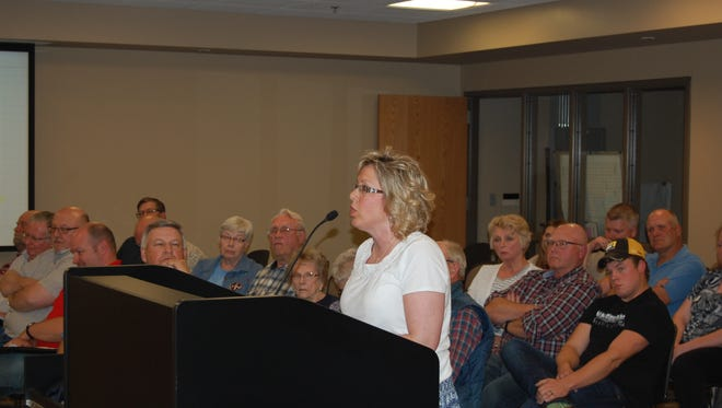Jennifer Fischer talks about her worries over wind turbines on May 5 in Canton