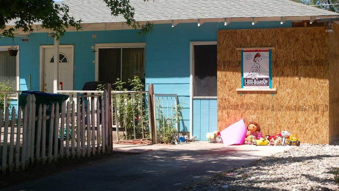 Toys were left in front of the Reno home where an SUV crashed into it Monday, killing two children.